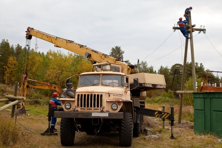 Installation of the power line supports using the crane photo