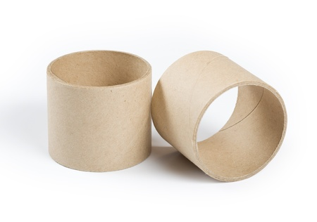 Cardboard cylinders on a white background