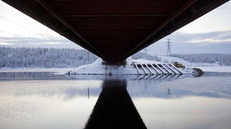 specular: Road bridge. View from below. Specular reflection on the water
