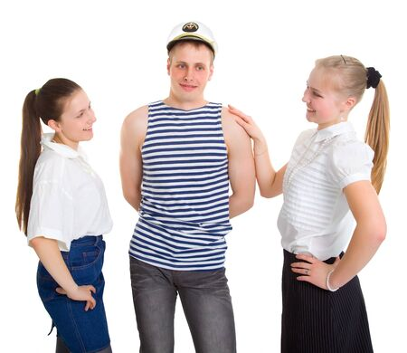 Two girls and a sailor. Isolated on white background photo