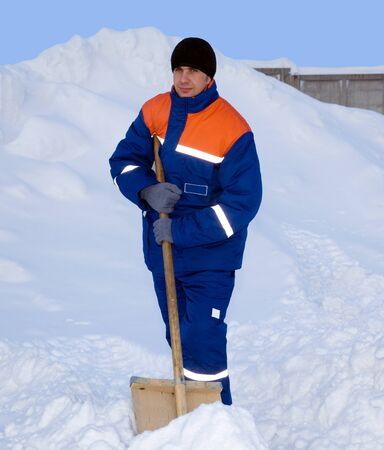 Worker in the winter suit consisting of a jacket and trousers against the backdrop of the snow Stock Photo - 12325681