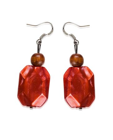 Earrings garnet color of glass and wood isolated on a white background  Collage  Stock Photo