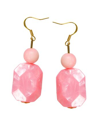Earrings made of pink plastic on a white background  collage