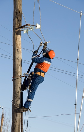 Electric eliminates the accident at the power line pole Stock Photo