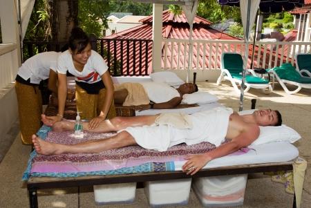Men get a Thai massage  Thailand, Phuket, Patong  Stock Photo