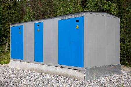 enclosures: Transformer substation closed execution against the green forest