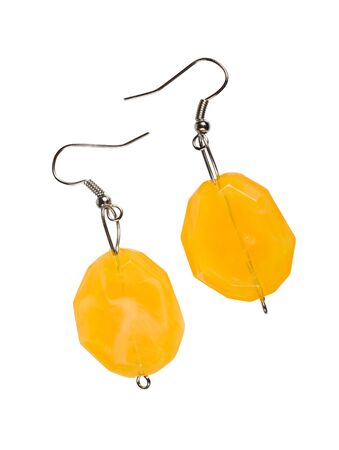 cutglass: Earrings out of the yellow cut-glass isolated on a white background