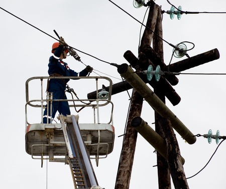 Electric is working on a pole in a special lift vehicles Stock Photo - 15358920
