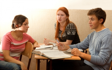 students discuss in class during recess  Bright sunlight Stock Photo