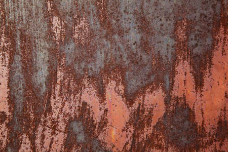 Rusty iron for background with faded brown paint