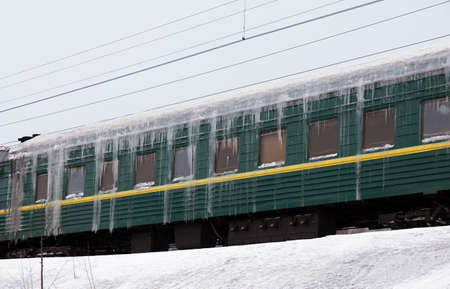 Passenger train covered with ice in snow Stock Photo