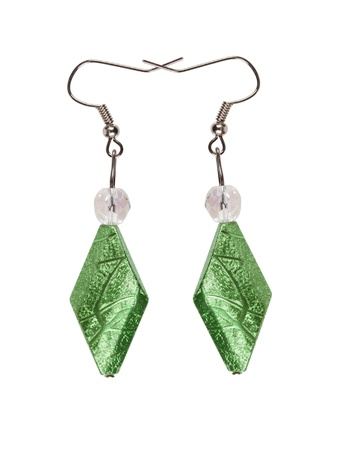 Earrings in silver diamond-shaped light green on a white background  Collage  Stock Photo
