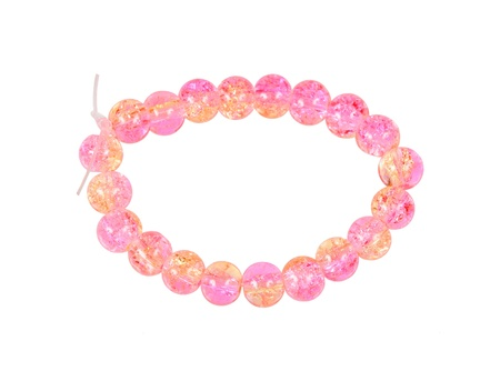 Pink bracelet of glass beads isolated on white background