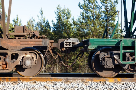 coupling: Freight wagon train  automatic coupling  In a forest and blue sky  Stock Photo