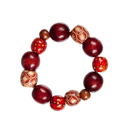 bracelet  made of wood red and brown color isolated on white background Фото со стока