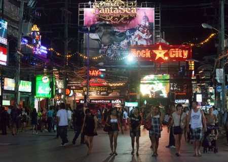 PATONG, THAILAND - APRIL 26, 2012: People walk in the evening on Bangla Road. Center nightlife  Patong famous Bangla Road. Patong, Thailand, April 26, 2012
