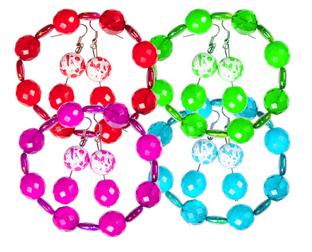 wristlets: Earrings and bracelets made of plastic and glass   isolated on white background. Collage.