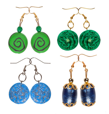 wristlets: Earrings made of plastic and glass isolated on a white background. Four pairs blue and green. Collage. Stock Photo