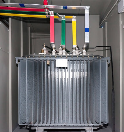 Power transformer in the compartment of steel. New electrical equipment