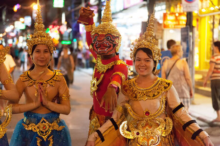 PATONG, THAILAND - APRIL 26, 2012: Street barkers on the show.  Bangla Road  center nightlife Patong. Patong, Thailand, April 26, 2012