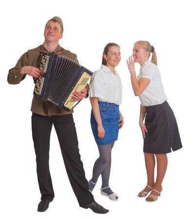 Two girls and a guy with an accordion in a soldier's uniform. Isolated on white background  photo