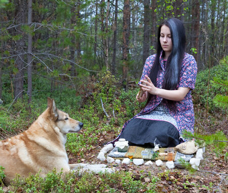 arcane: Beautiful girl witch prepares witchcraft the drug in the woods.