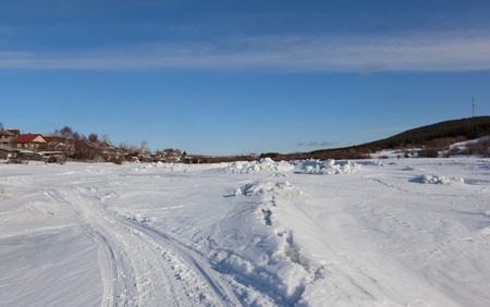 frost bound: River under the snow and ice in Russia