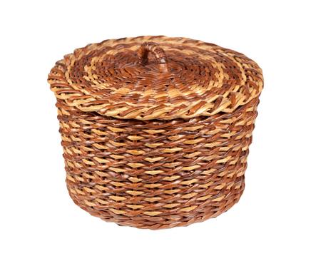 basket brown-yellow made using newspaper tubes isolated on white background Stock Photo