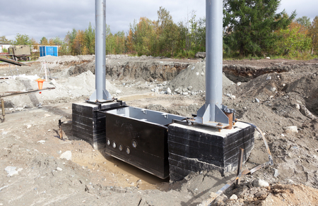Metal and concrete structures are assembled for installation on construction site Stock Photo