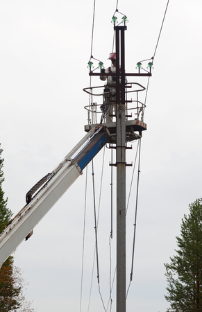 Electric is working on a pole in a special lift vehicles
