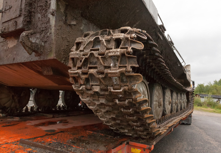 The tracked vehicle pulled into the trawl for transportation to a destination Stock Photo