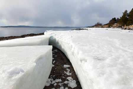 Lumps of ice on the shore of the northern sea during the period of thawing in the spring