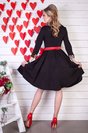 beautiful young girl advertises clothing, background adorned wit
