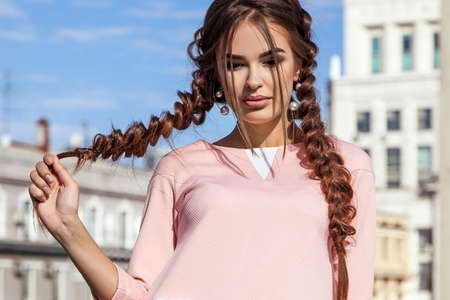 boldness: beautiful young girl on the background of the urban landscape in Stock Photo