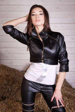 beautiful young girl in a dress in the hay, leather garments, na 版權商用圖片