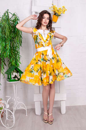 beautiful young girl advertises a dress.