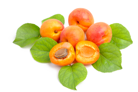 sliced fruit: Fresh whole apricot and sliced fruit apricot with leaves isolated. Stock Photo