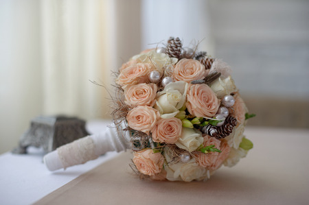 wedding bouquet of  pink and white roses with cones