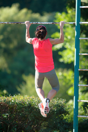 strong chin: Strong woman athlete is Chin-ups and Pullups training on an abandoned sports field. Pull-up on the bar. Athlete Outdoors.