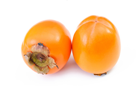 pair of ripe persimmons isolated on white Stock Photo