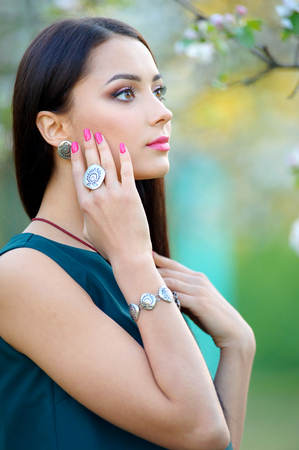 Beautiful young woman with jewelry luxury accessory. Spring collection. Beauty outdoors portrait