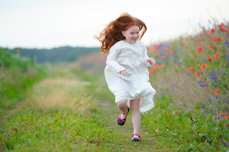 beautiful girl with long golden hair running toward funny smiling