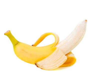 bannana: Partly peeled Banana isolated on white background