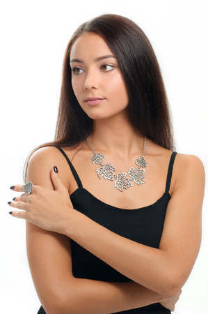 portrait of beautiful woman wearing luxury silver Jewelery. Necklace and finger ring on human model
