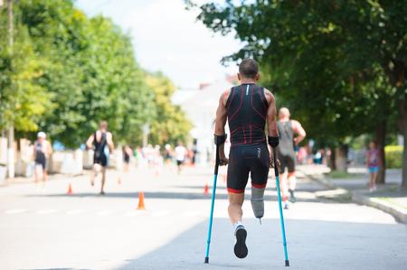 Triathlon Cup of Ukraine and Cup of Bila Tserkva. July 24, 2016 in Bila Tserkva, Ukraine. Back view of disabled paralympic athlete