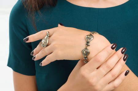 bracelet and finger ring on a hand. Fashion accents, jewelry.