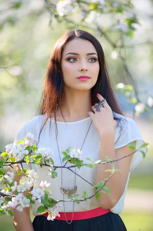 young model with clear beautiful face wearing silver accessory. Spring jewelry collection