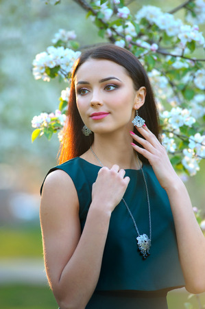 Luxury jewelry spring collection. Beauty fashion girl model portrait. Healthy Long Hair. Attractive brunette young Woman with makeup