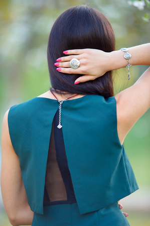 woman with jewelry luxury accessory. Back view. Spring collection. Beauty outdoors portrait