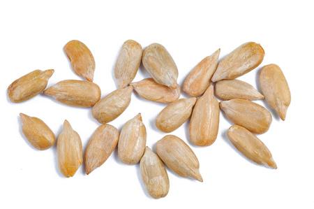 peeled sunflower seeds on white surface. Stock Photo